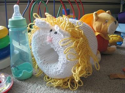 Lion Snuggly Bottle Warmer Knitting Bee