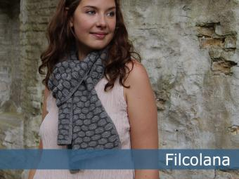 A scarf with a cobble stone pattern