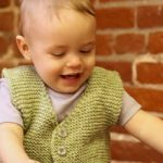 Easy to knit garter stitch baby vest. Free baby vest knit pattern.
