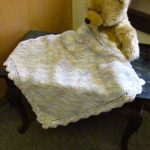 garter stitch baby blanket with crochet border. Free baby knit pattern.