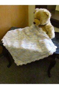 garter stitch baby blanket with crochet border. Free baby knit pattern.