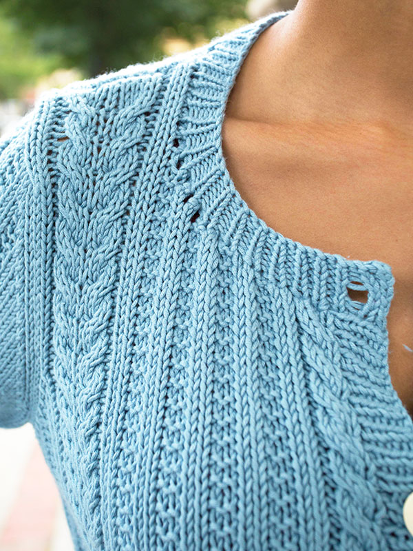 A cardigan with beautiful cables, Watson is a classic New England summer sweater.
