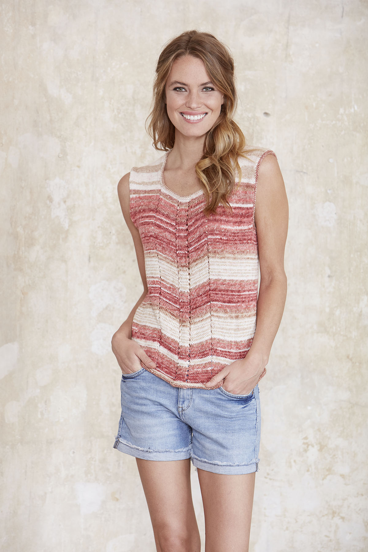 Summery Top Free Knitting Pattern. Modern top with eyelet feature in the front to knit for free with this pattern. This top looks great knit with variegated yarn and is sure to be one of your favorite go to Summer knit tops.