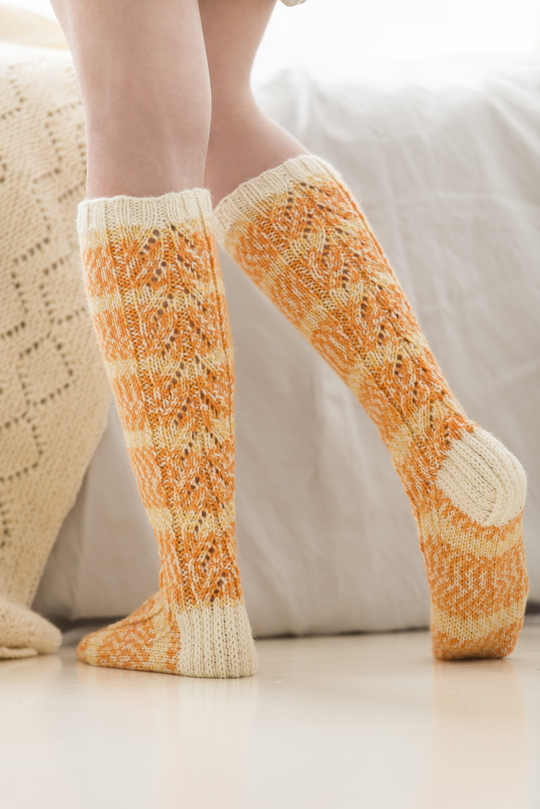 Free Knitting Pattern for Women's Knee-High Socks with lace stitch.