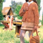 Free knitting pattern for a cabled girls jacket and matching skirt and bag. Perfect for girls aged 7 to 8.