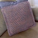 Free Knitting Pattern for a Trinity Cushion Cover.