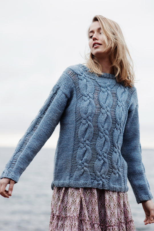 Free Knitting Pattern for a Women's Cabled and Drop Stitch Sweater.