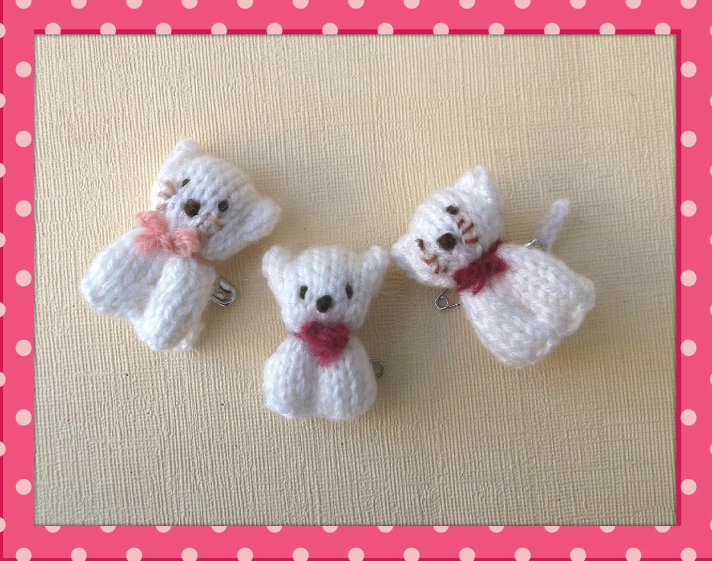 Free knitting pattern for Knitted bear and cat pins.