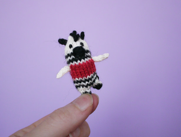 Free knitting pattern for a tiny zebra animal.