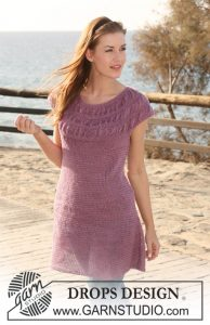 Free knitting pattern for a gathered stitch yoke dress with short sleeves