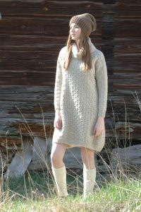 Free knitting pattern for an all over cabled dress with turtleneck