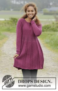 Knitted dress with raglan and cables, worked top down. Short dress with long sleeves.