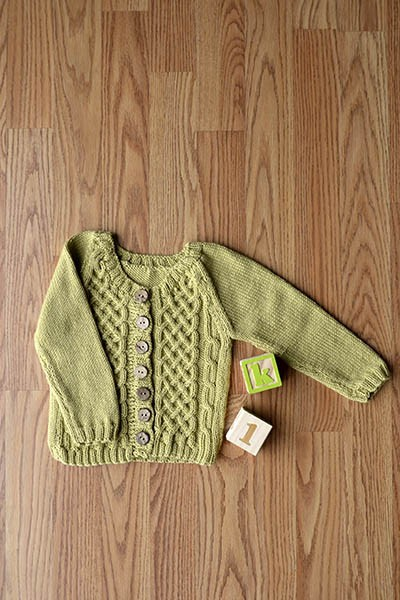 Free knitting pattern for a cable baby cardigan