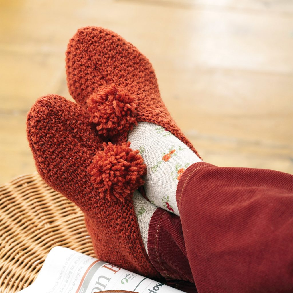 Free knitting pattern for textured slippers with pom pom