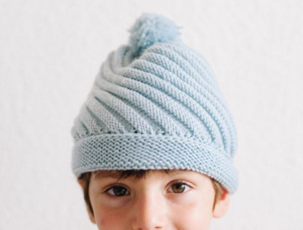 Free Knitting Pattern for a Diagonal Rib Swirl Beanie with Pompom