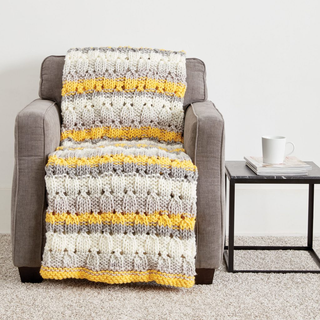 Free Knitting Pattern for a Patchwork Blanket in Bulky Yarn. Easy blanket knitting pattern.