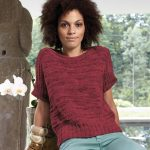 A mix of garter stitch and drop stitches provides the basic pattern for this summery knitted shirt. Wide ribbed bands are knitted on Instead of sleeves, a perfect addition to the high waistband. They also add a casual touch. Sizes XS – XL.