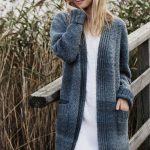 This long ladies cardigan with pockets is knitted in a combination of mock fisherman's rib and broken seed stitch.