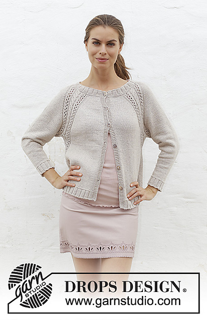 Knitted jacket with raglan, cables, lace pattern and split in sides, worked top down.