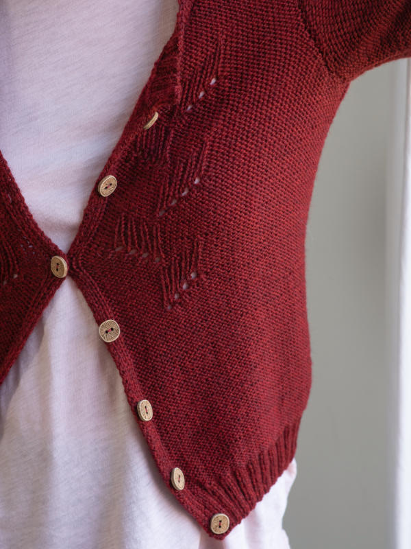 Free Knitting Pattern for an Eyelet Stitch Cardigan for women.