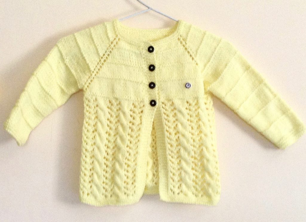 Free Knitting Pattern for a Lemon Swing Kids Jacket for 3 to 5 year olds.