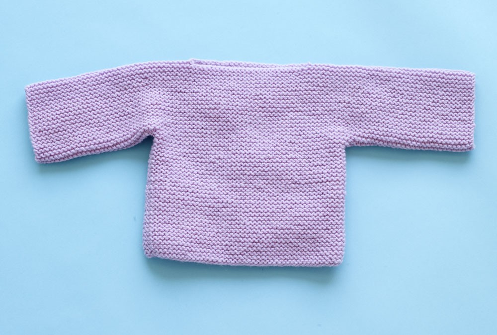 Free knitting pattern for an easy one piece garter stitch baby sweater