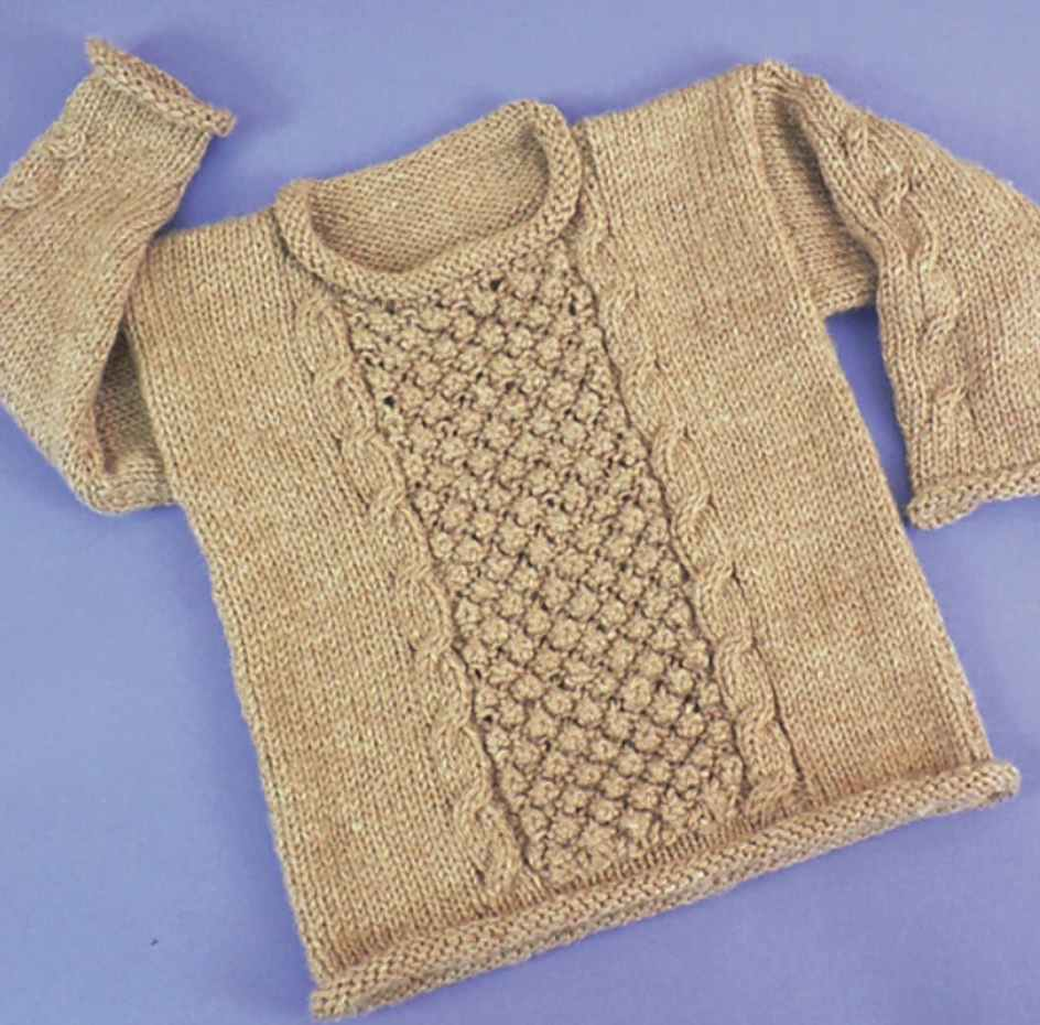 Free knitting pattern for a child aran pullover