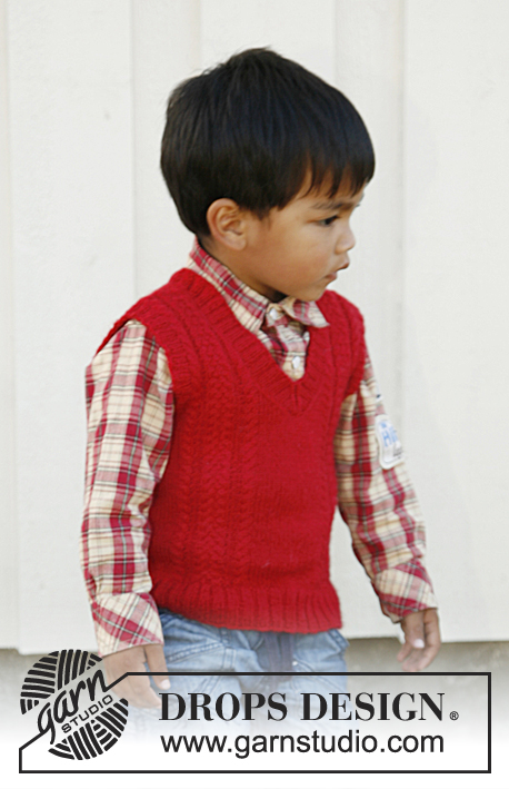 free knitting pattern for a Boys v-neck vest with cables for ages 3 to 12