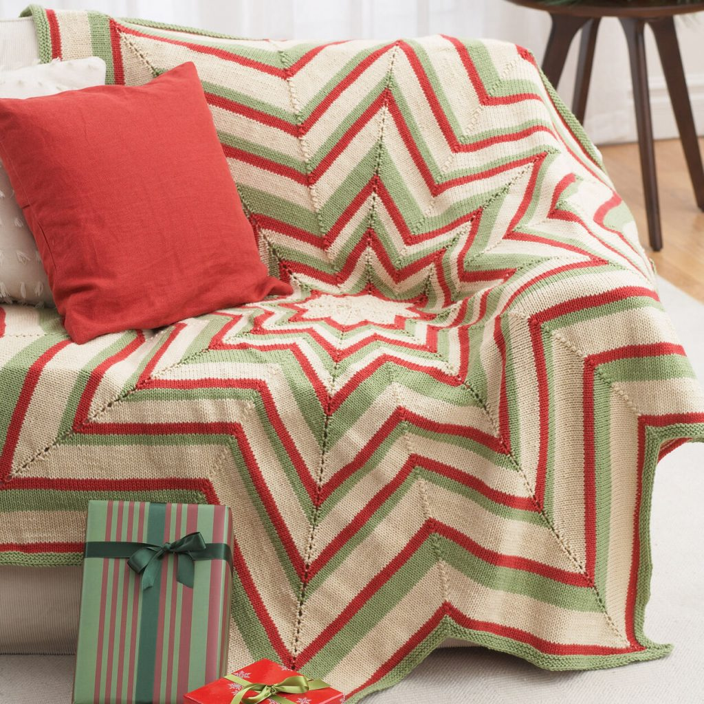 Free knitting pattern for a star shaped Christmas blanket