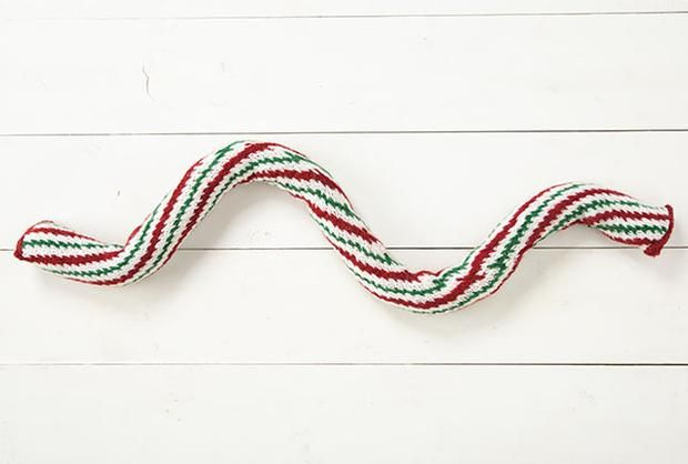 Free knitting pattern for a candy cane door draft stopper