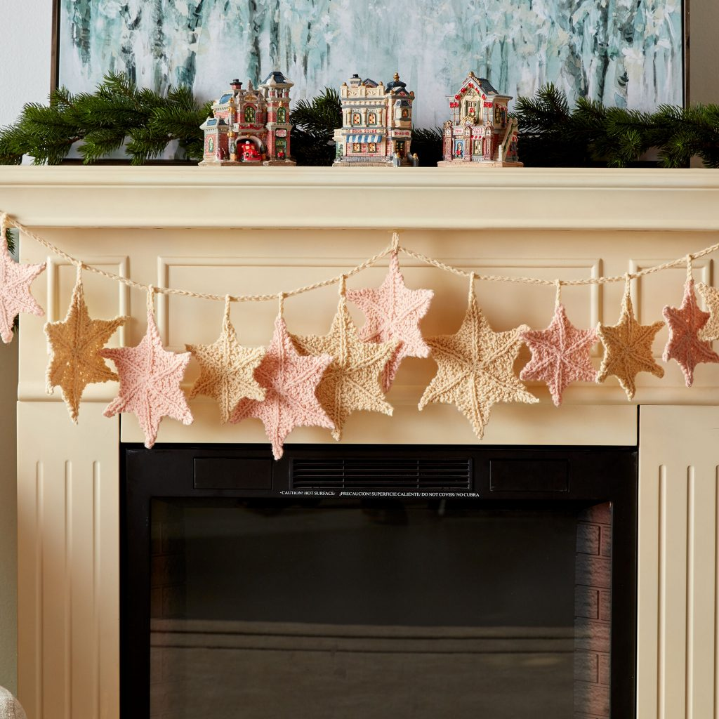 Free knitting pattern for a festive star garland