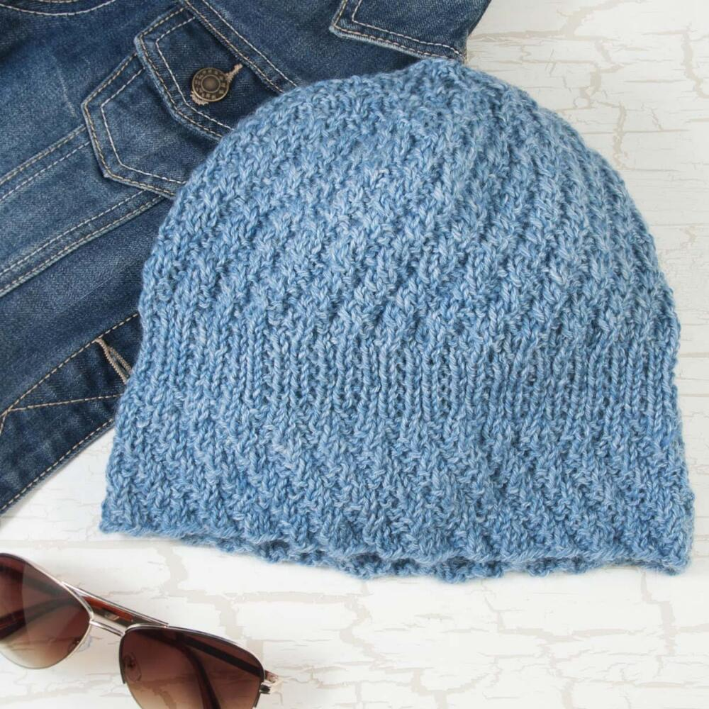 Casual yet chic, this textured hat with a denim look is perfect for chilly fall days. Free hat knitting pattern