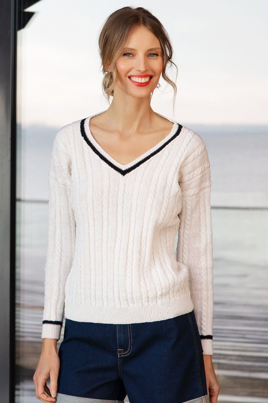 Classic sailor knit sweater. Easy and free knitting pattern for a woman's sweater with cables and v-neck.