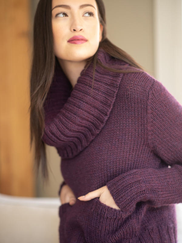 Free knitting pattern for a cozy sweater with a knit in pieces from the bottom up, featuring a small front pockets and a deep ribbed cowlneck