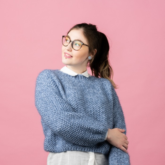 Free knitting pattern for a cute ladies sweater in seed stitch with a ribbed round neckline