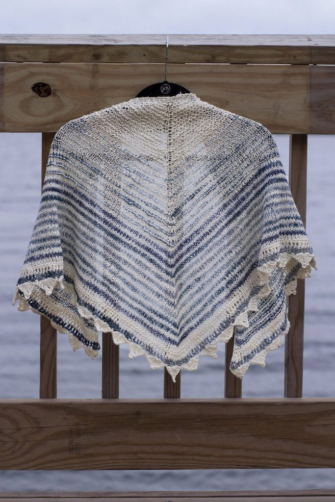 Free knitting pattern for a triangle striped Summer shawl