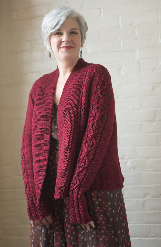 Free knitting pattern for a cabled cardigan for women