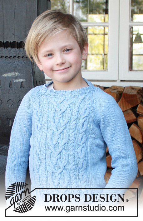 Knitted sweater for kids with raglan and cables free pattern