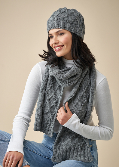 Free knitting pattern for a diamond cable hat and scarf set