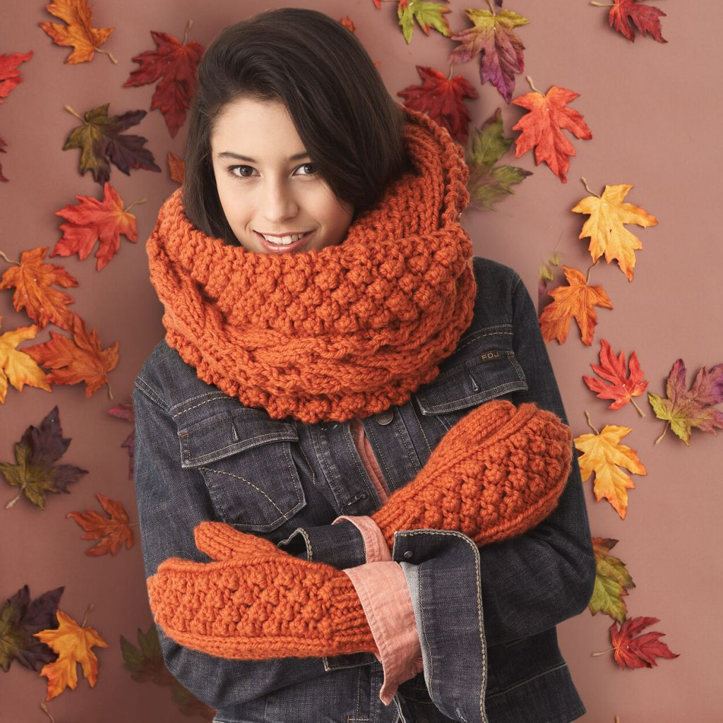 cowl and matching mittens with a cabled and bobble stitch in super chunky yarn free knitting pattern