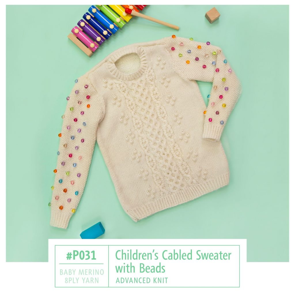 Free Knitting Pattern for a cabled kids sweater with beads